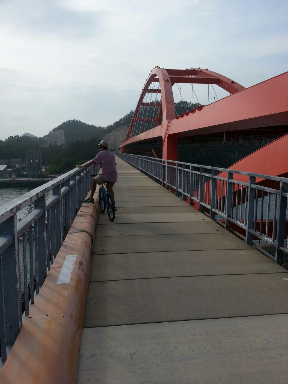 Biking across a bridge between islands