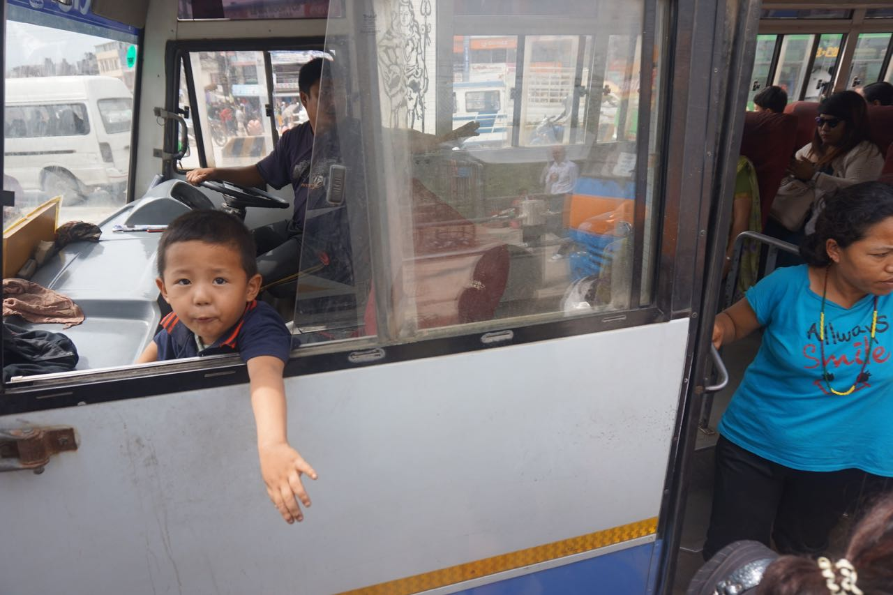 Boy Riding Shotgun on a Bus